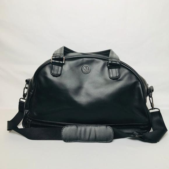 c52733d82bad lululemon athletica Handbags - Lululemon Black Duffle with Blue Floral  Interior